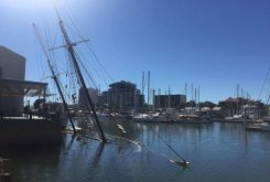 Vandalism suspected as historic tall ship Defender sinks in Townsville